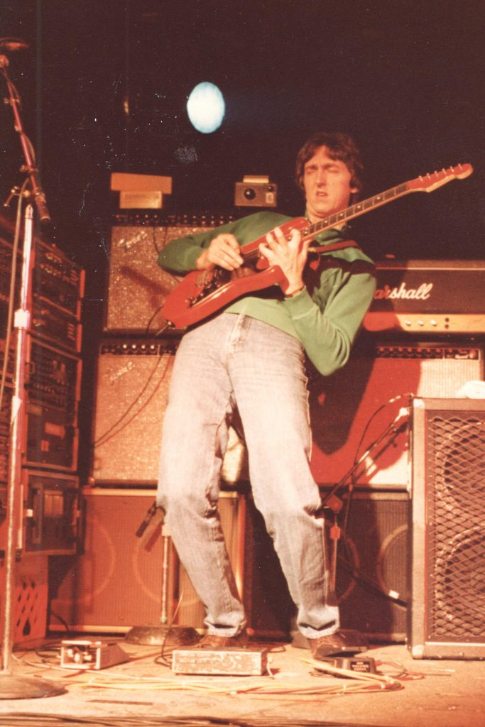 Allan Holdsworth playing guitar